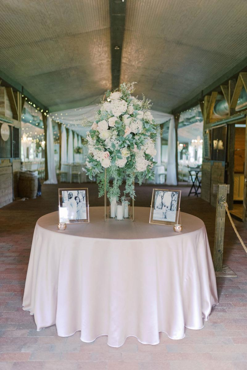 The dreamy blush and white entrance table at the Carriage House Stable