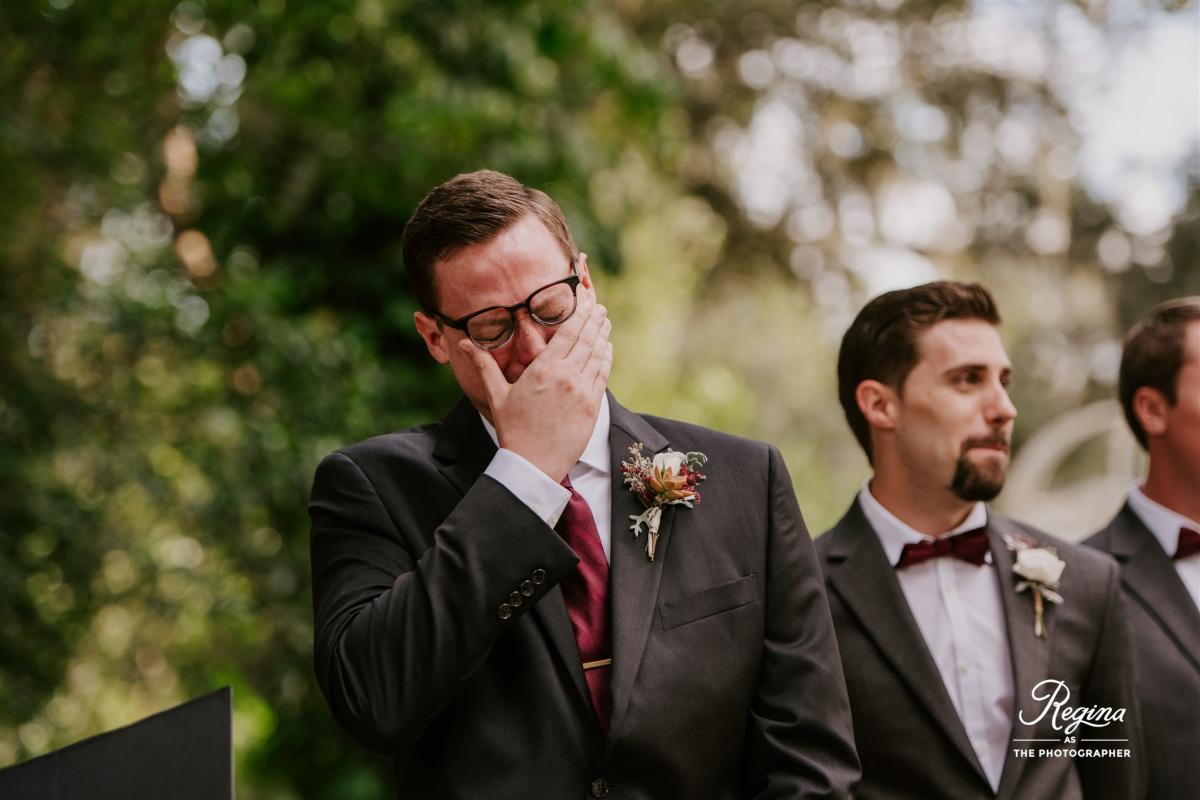 Jacob holding back tears as he sees Kalee walking down the aisle