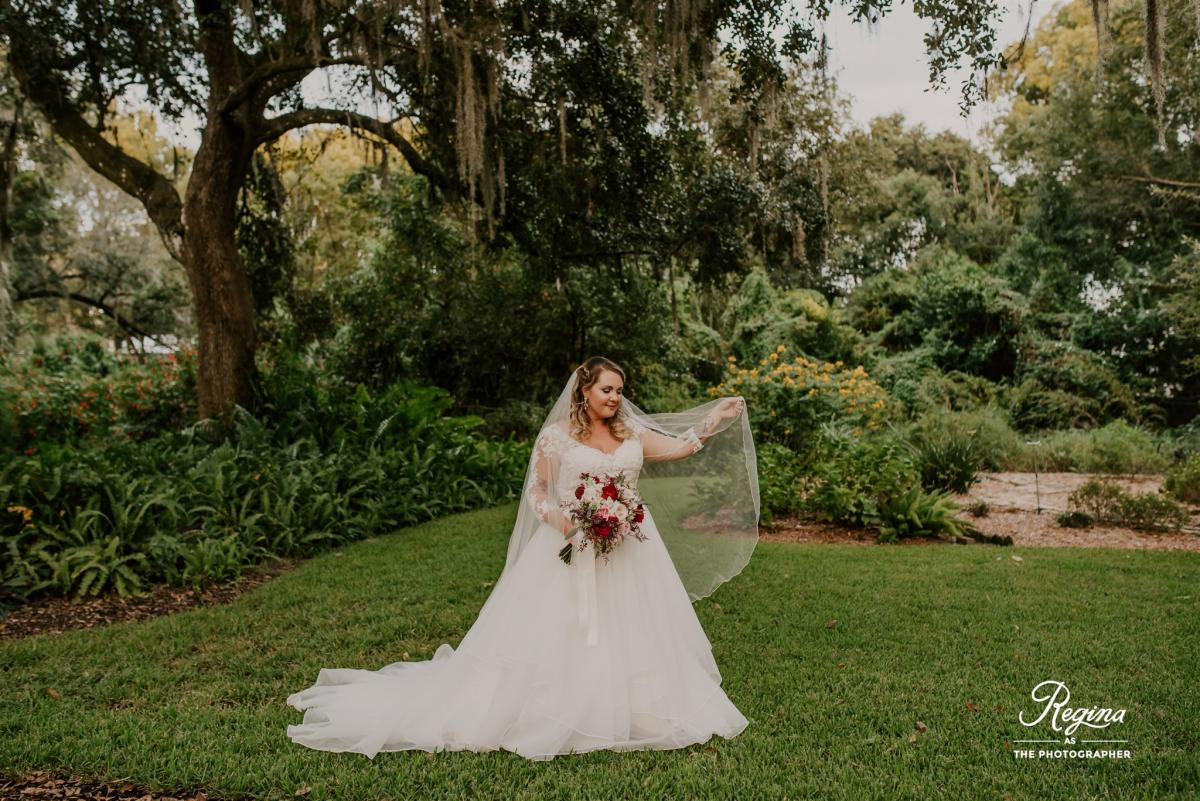 Kalee in her three quarter lenght sleeve ball gown with lace applique
