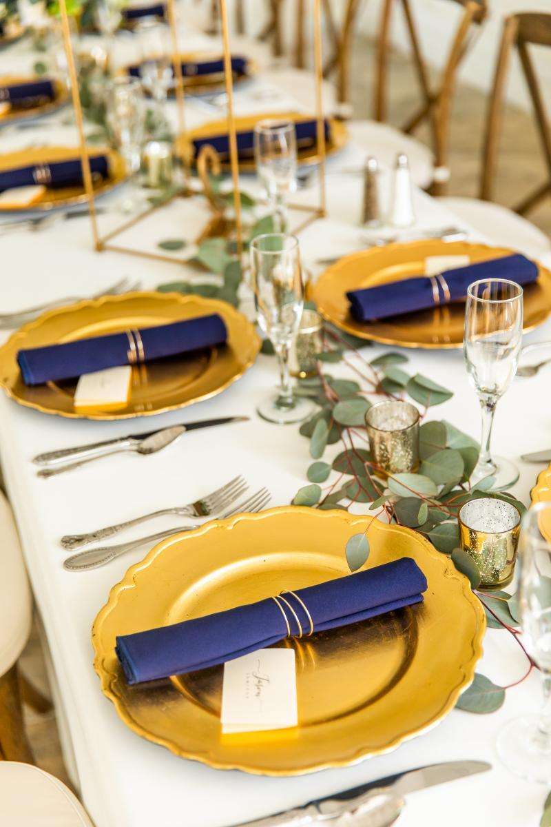 Rustic luxe wedding centerpieces and place setting
