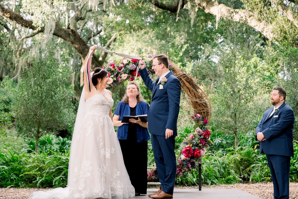 Tying the knot during their hand fasting ceremony
