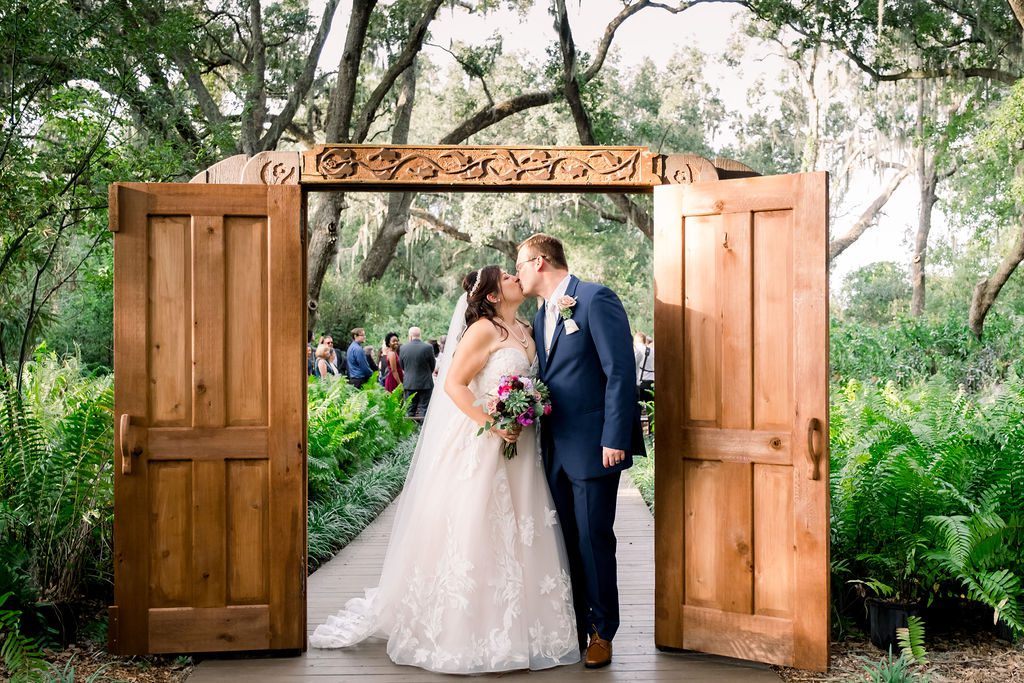 Kiss under the Enchanted Forest doors