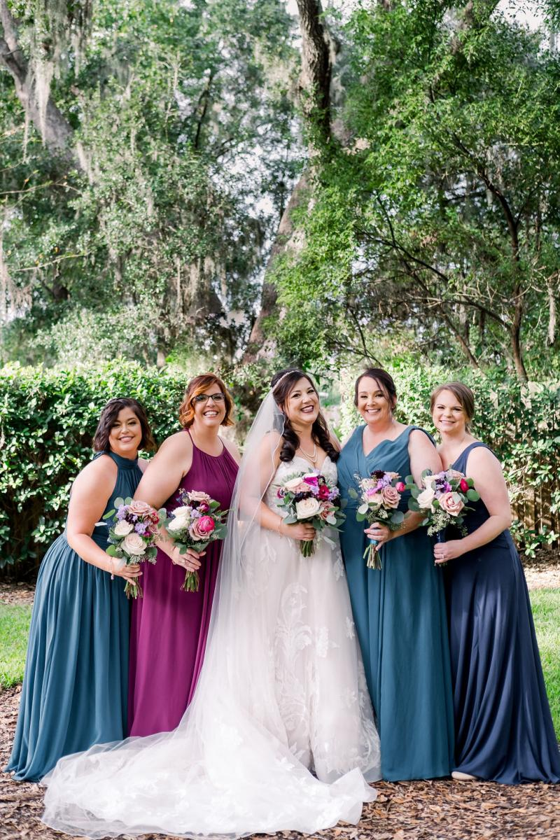 Mandy's bridesmaids in jewel toned dresses
