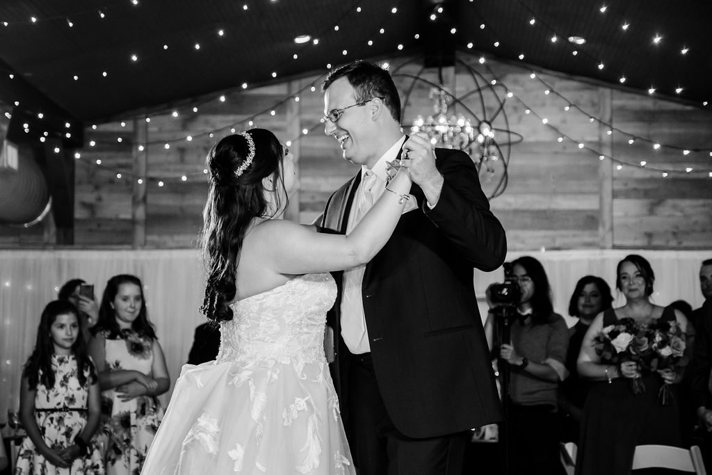 Dancing underneath the twinkle lights inside the Carriage House Stable