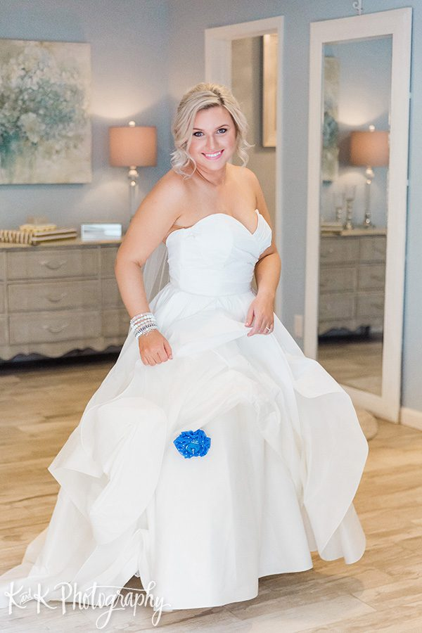 Lauren's something blue attached to the bottom of her wedding dress