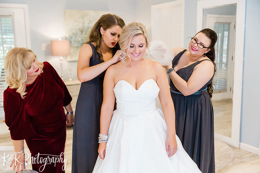 Lauren getting her wedding dress on with the help of her bridal party