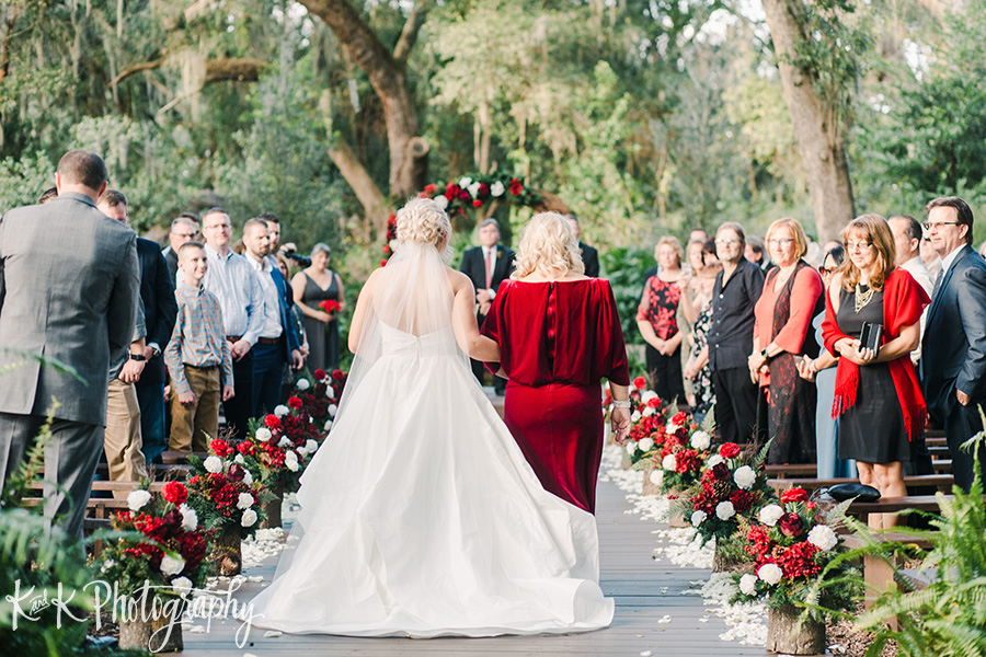 Lauren and her mom walking down the aisle