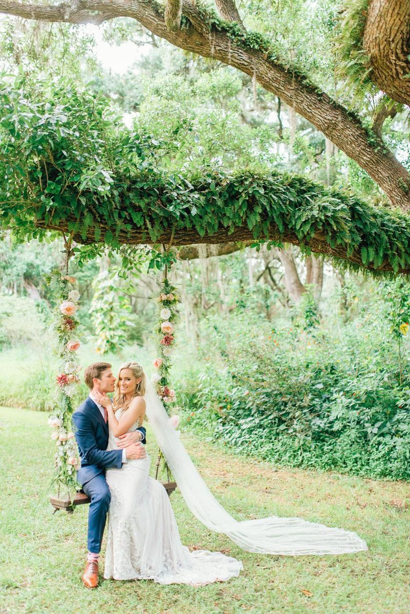 The newlyweds sitting on the elegant wedding swing