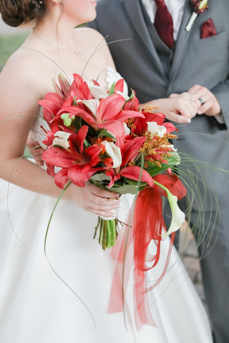 Tropical and whimsical burgundy and red wedding bouquet