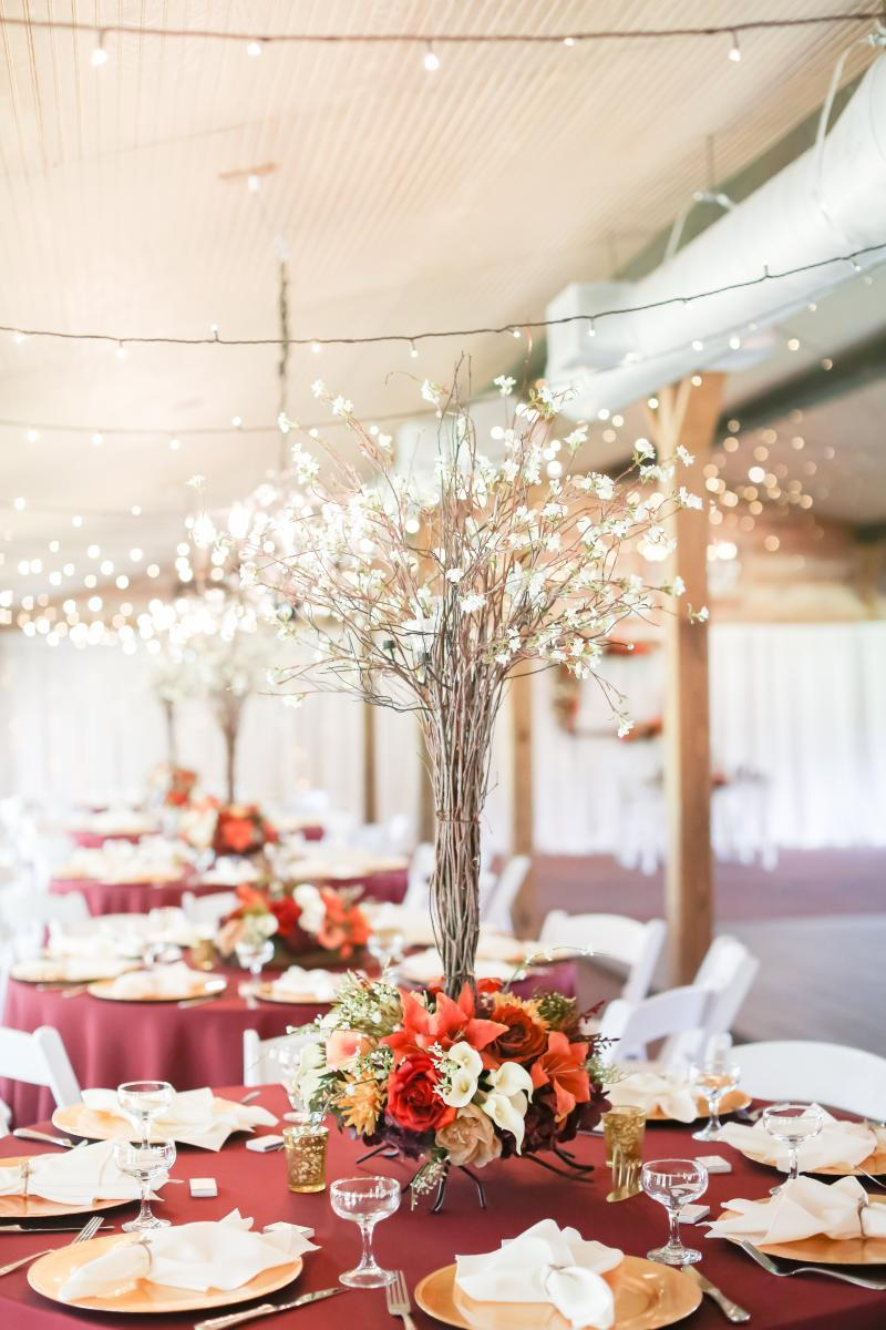 Whimsical burgundy wedding reception decor