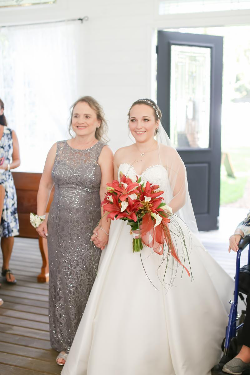 Laura walking down the aisle with her mother