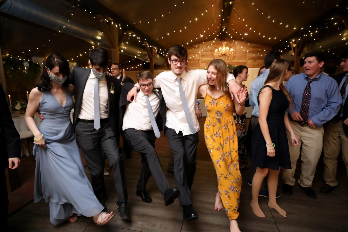 Wedding reception inside a barn wedding venue