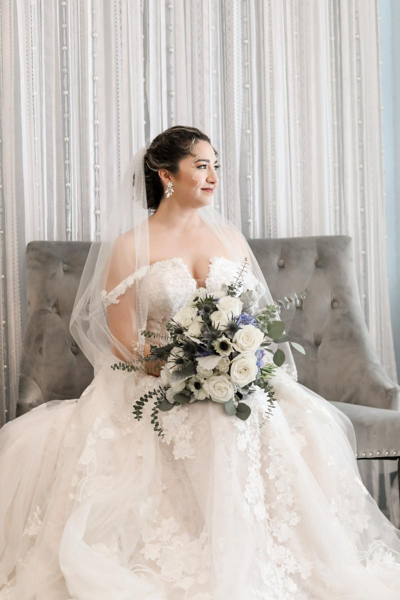Mary Cate looked stunning in her deep V-neck wedding gown with cap sleeves