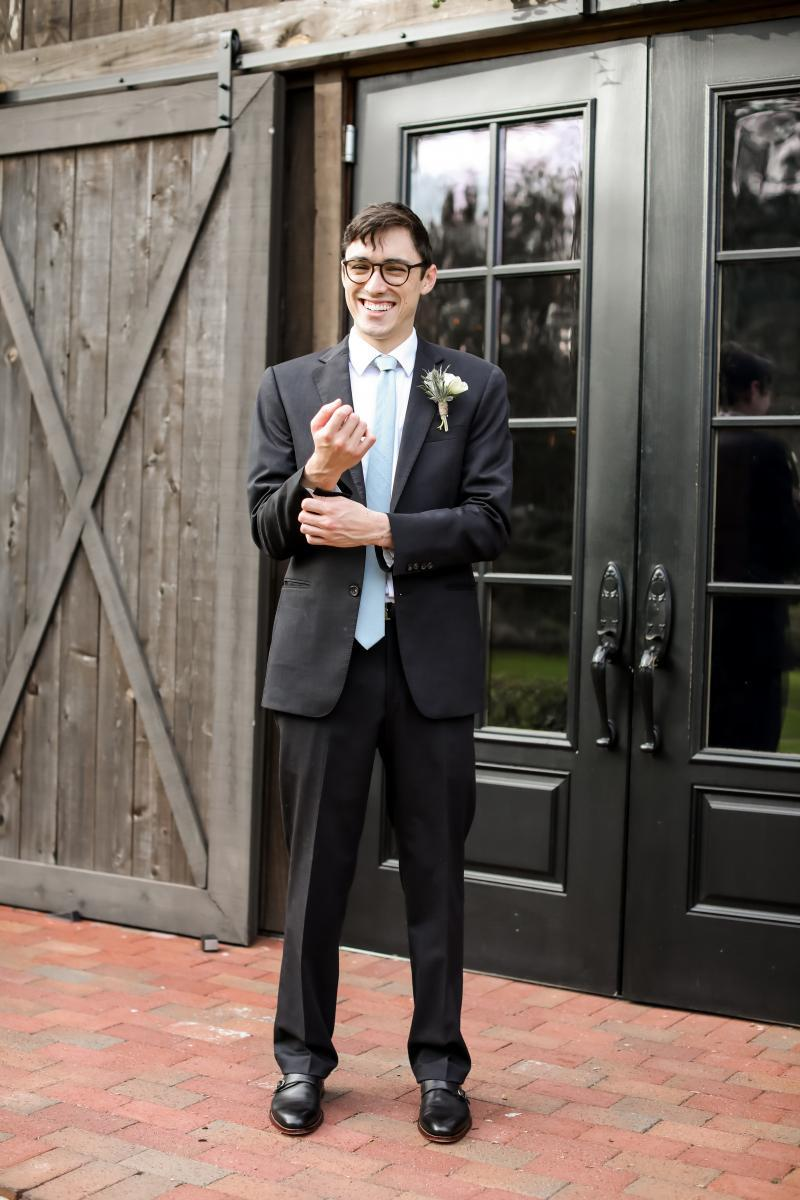 Black groom's suit with dusty blue tie