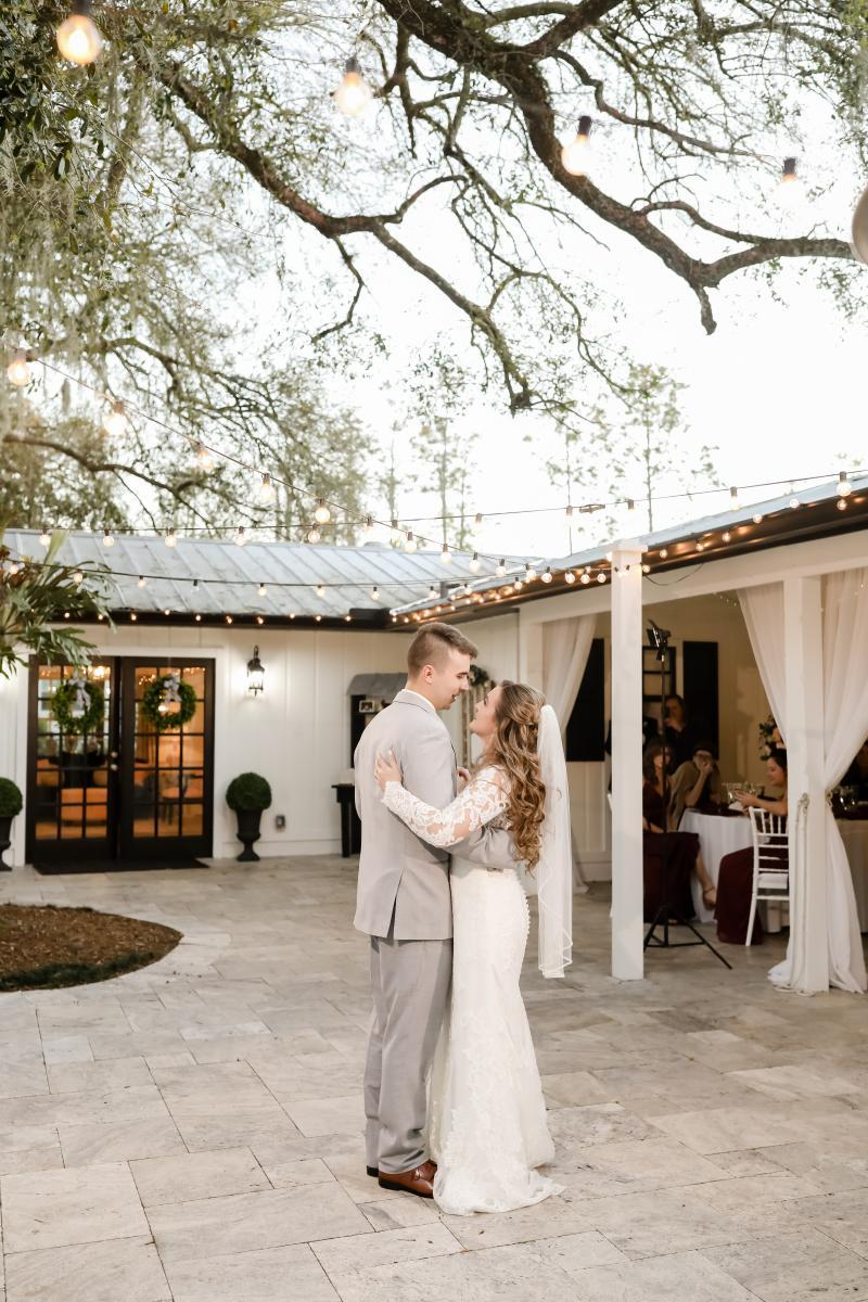 First dance underneath the string lights