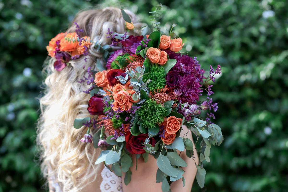 Florals in hair and moody boho bouquet