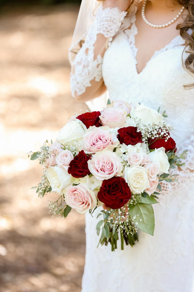 Beautiful bouquet of blush and burgundy wedding flowers