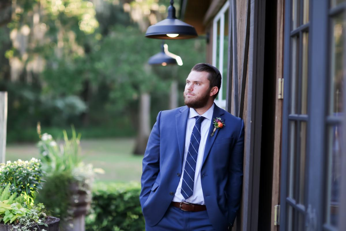 Groom model wearing a navy blue suit