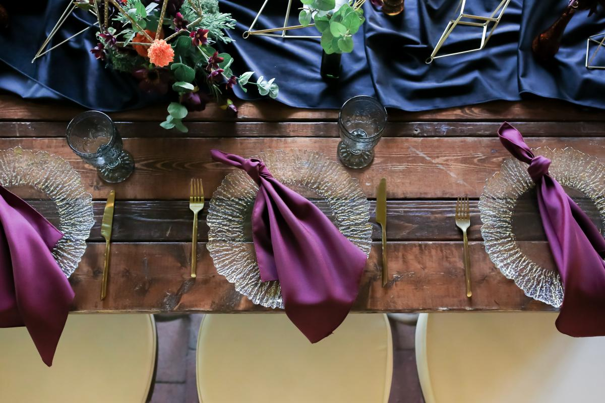 Chargers and napkins for the moody boho styled shoot