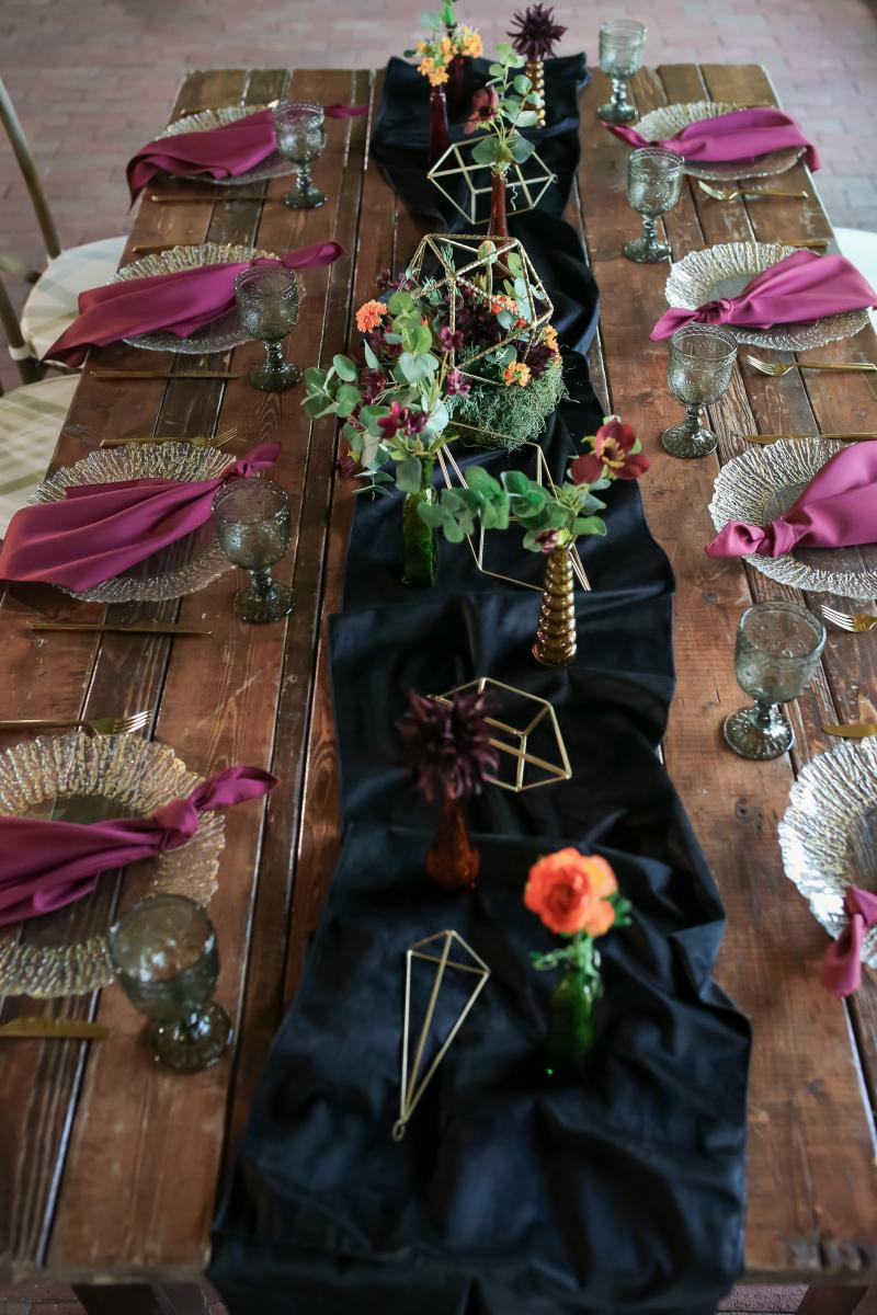 Black velvet runner on the wooden farm house table