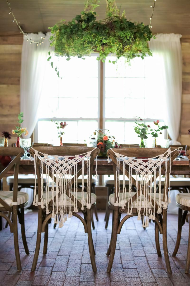Macrame decor on wooden cross back chair