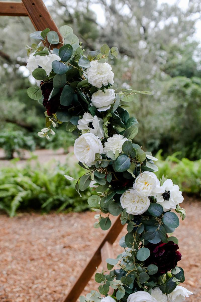 Greenery and white flowers decorated the hexagon ceremony arch