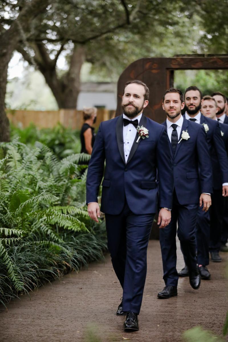 Jack and his groomsmen walking down the aisle