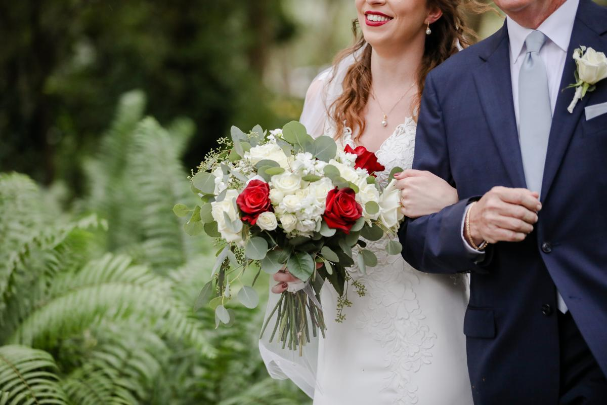 Bridal bouquet with cream and red roses and lots of greenery