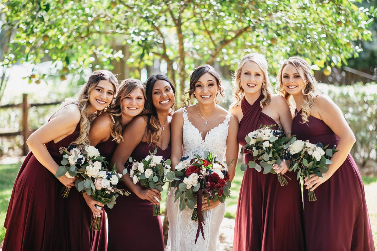 Tahai and her bridesmaids in burgundy