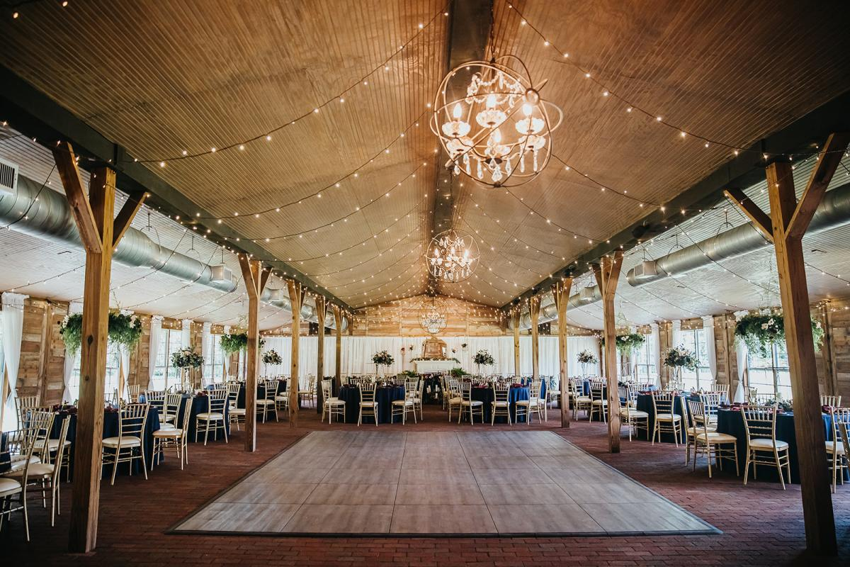 Inside the Carriage House Stable decorated for a modern boho wedding
