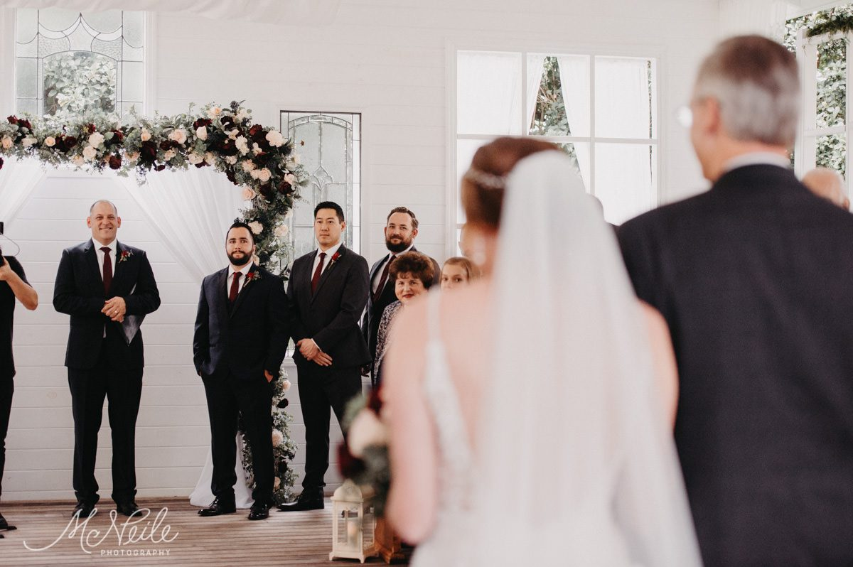 Sarah walking down the aisle with her dad