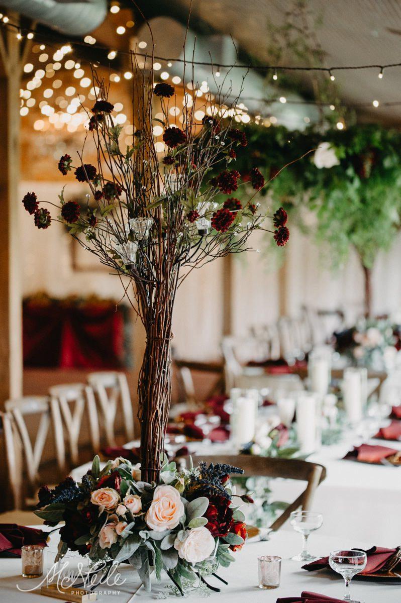 Earthy and enchanting wedding reception centerpiece