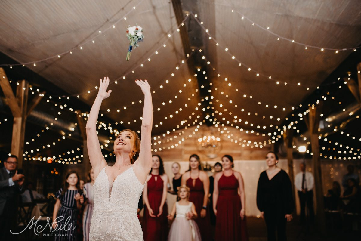 Sarah tossing her bouquet to all the single ladies