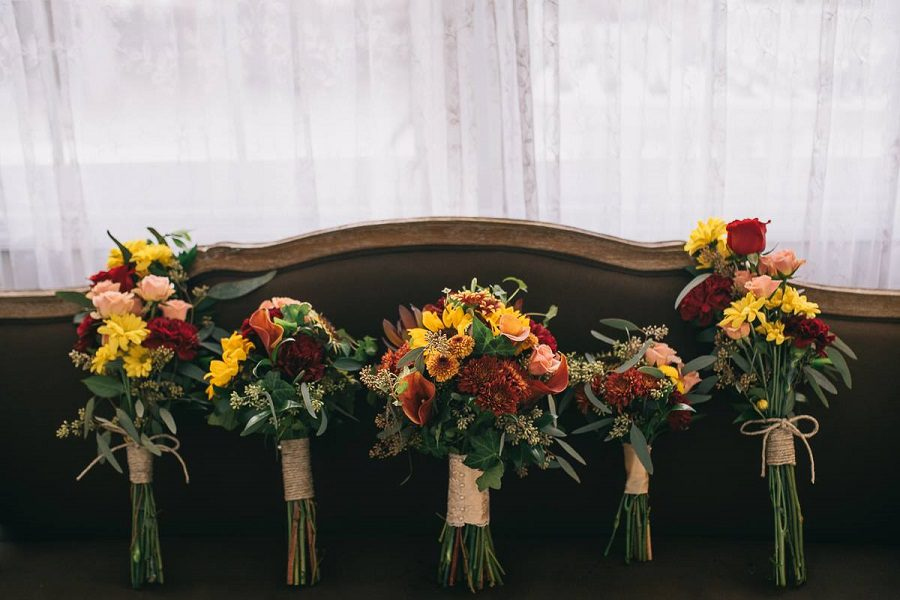 The lovely ladies' fall colored bouquets!