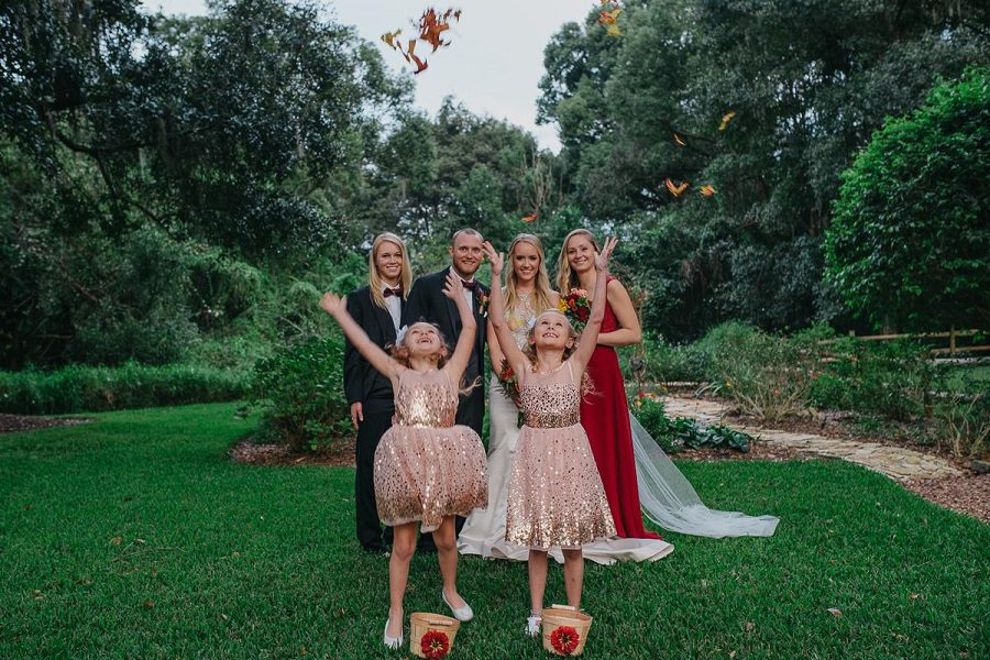 The wedding party - love the flower girls throwing the fall leaves!