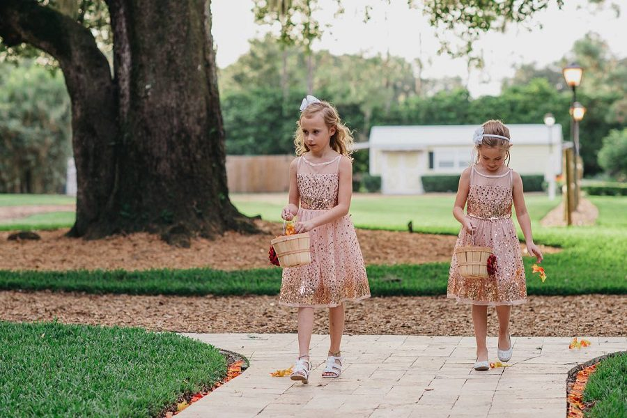 The flower girls making way for the bride.