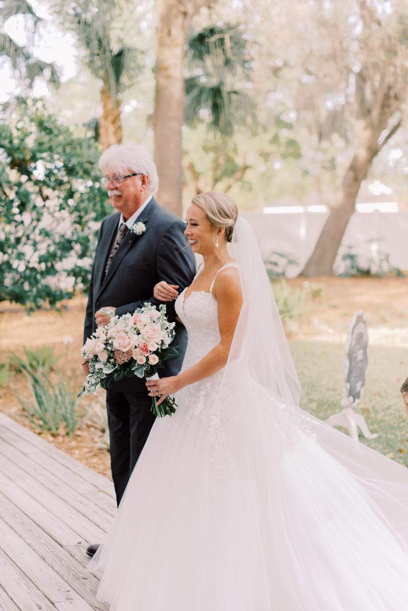 Mikaela and her father getting ready to go down the aisle