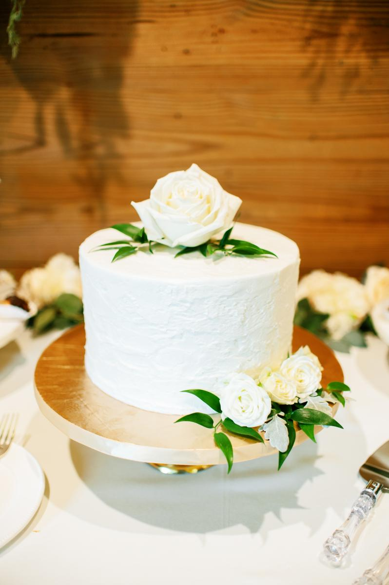 Modern romantic one tier wedding cake with white roses