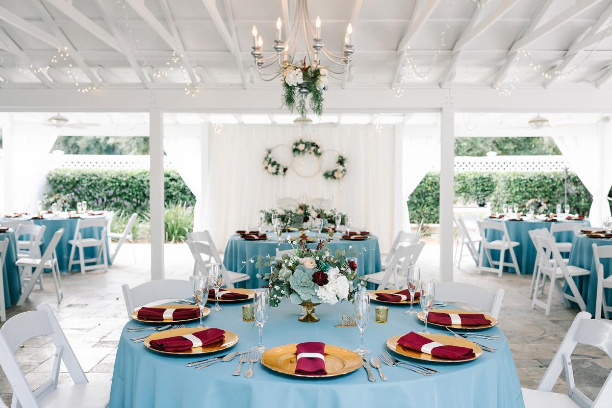 Dusty blue and burgundy wedding reception