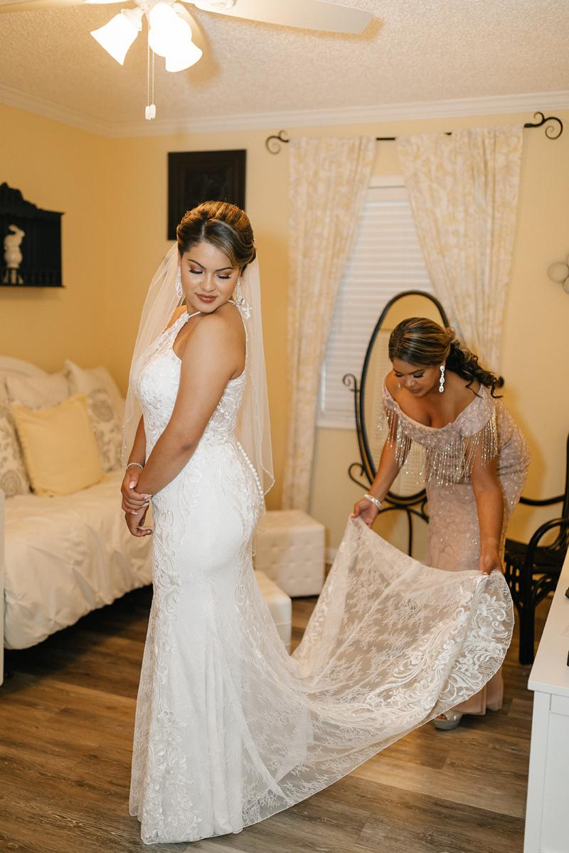 Ashley getting her halter top all lace fitted wedding dress on