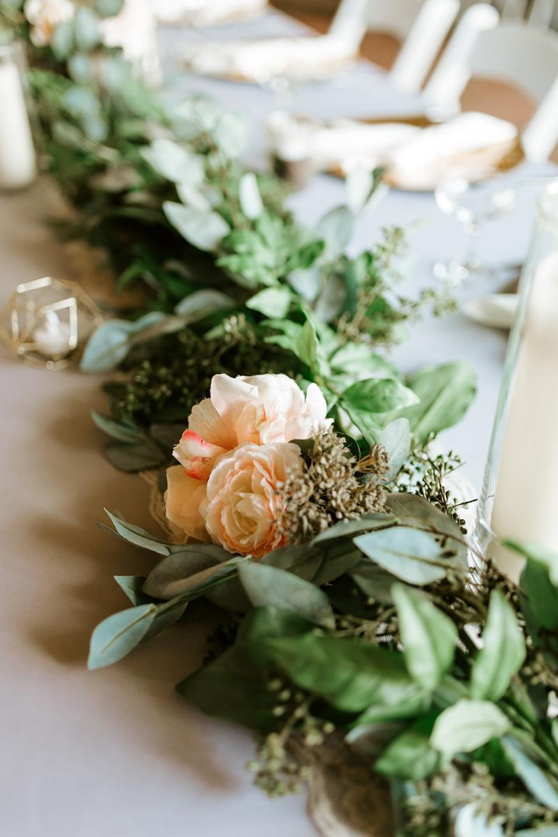 Peach and cream wedding flowers with greenery