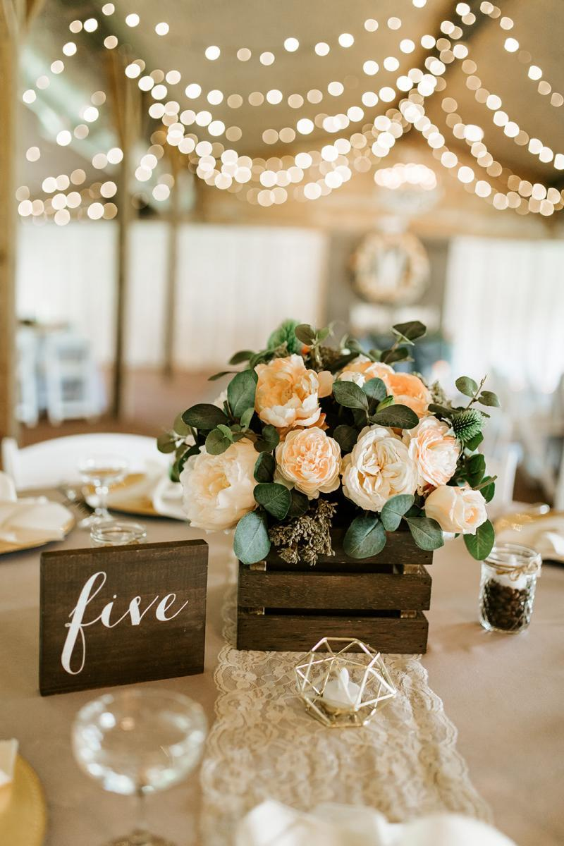 Rustic wedding centerpieces with peach wedding flowers