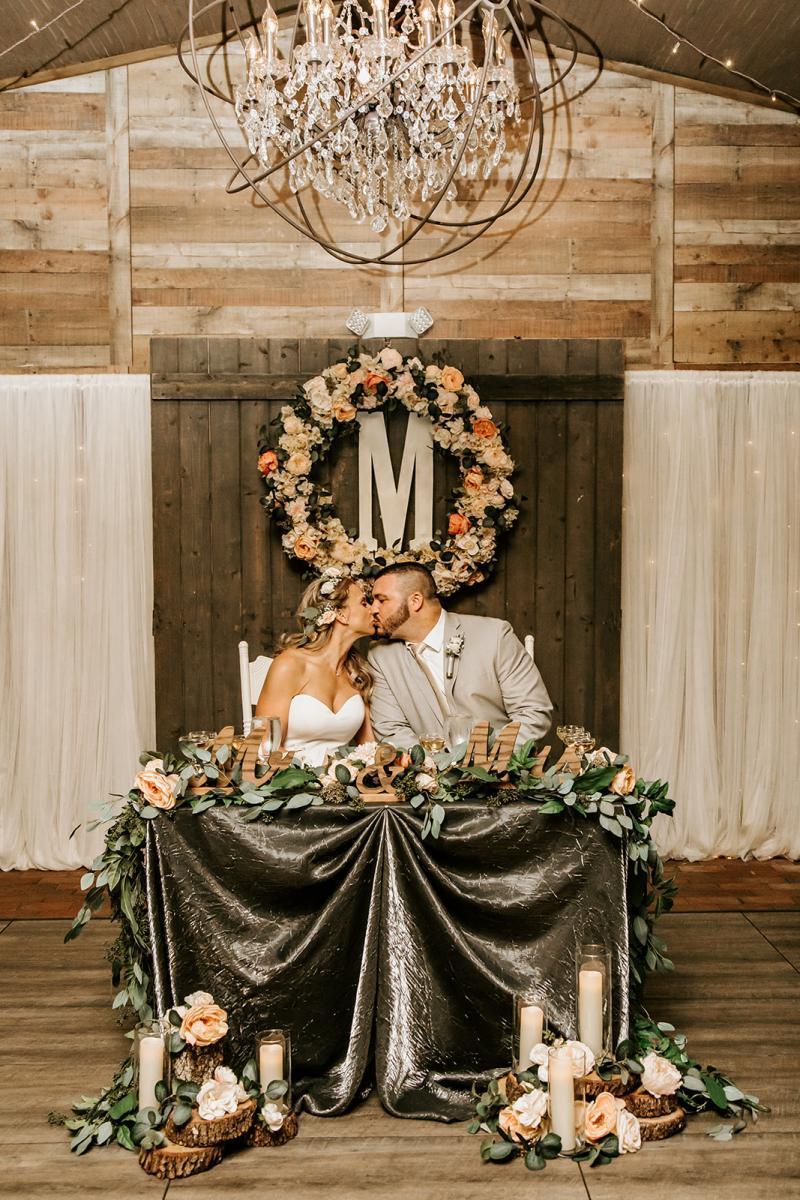 Ashley + Sal's rustic wedding sweetheart table