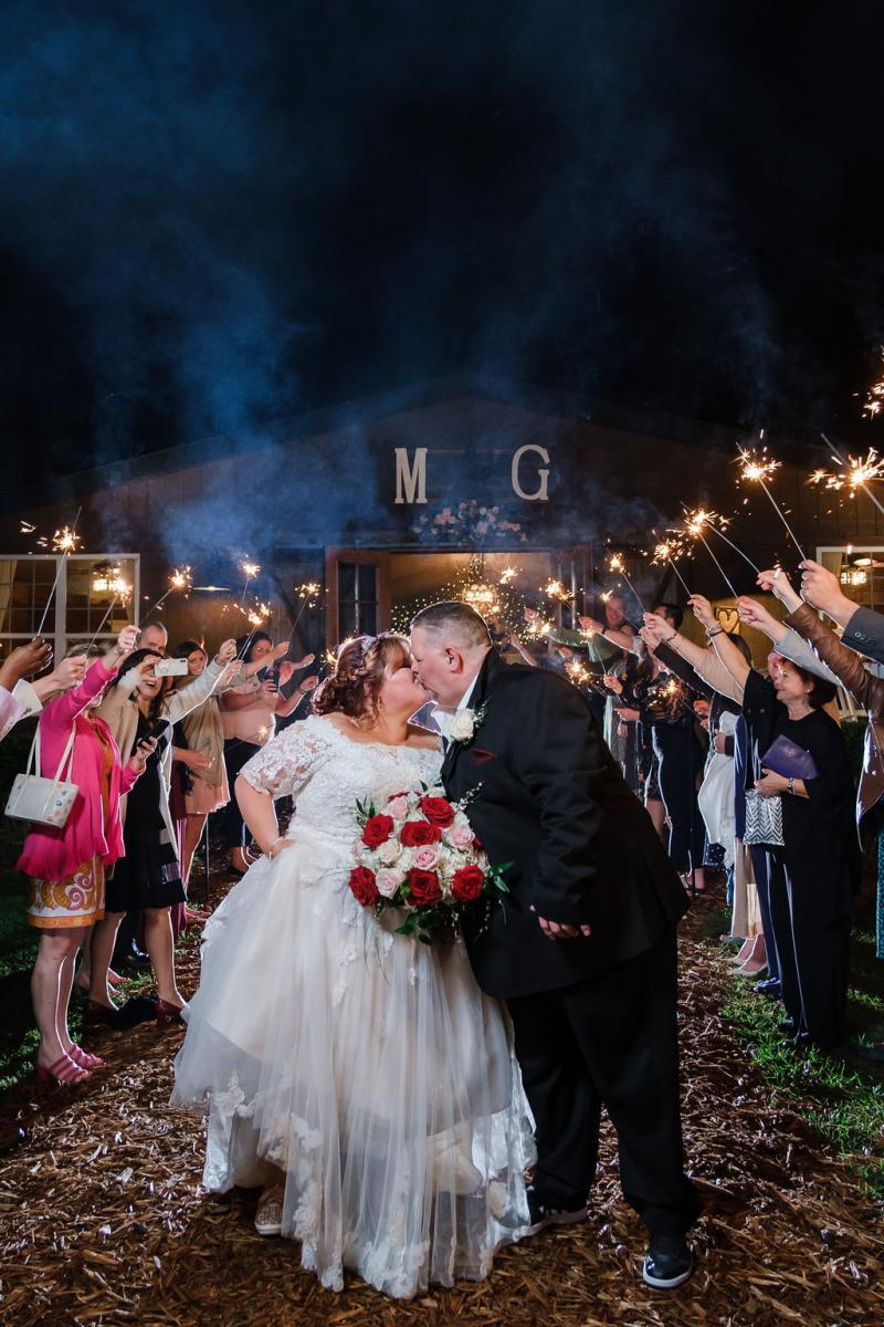 Sparkler exit in front of a barn venue