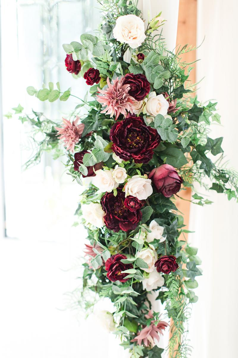 High quality silk flowers decorated the wooden arch for their chapel ceremony.