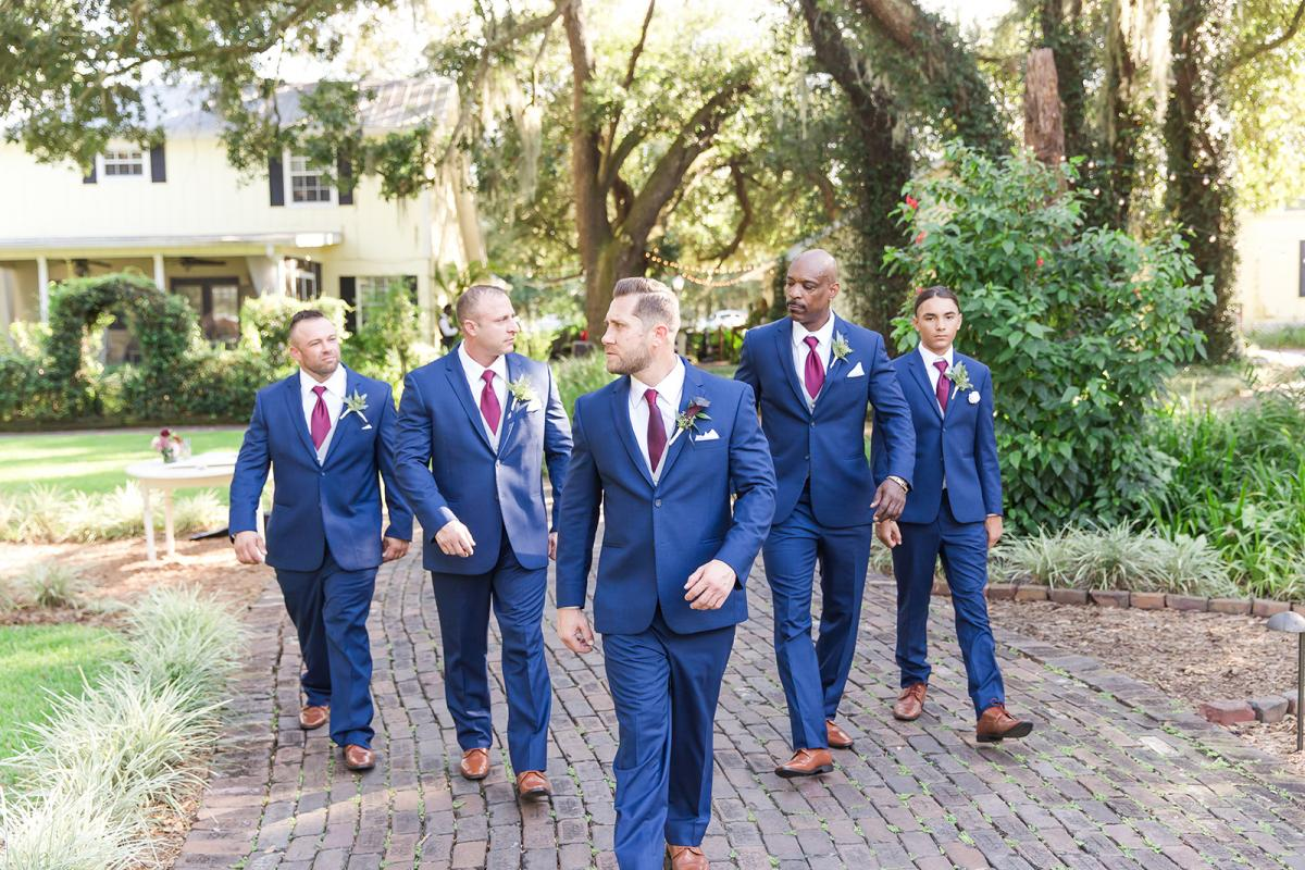 William and his groomsmen wearing navy suits for his wedding day at Cross Creek Ranch.