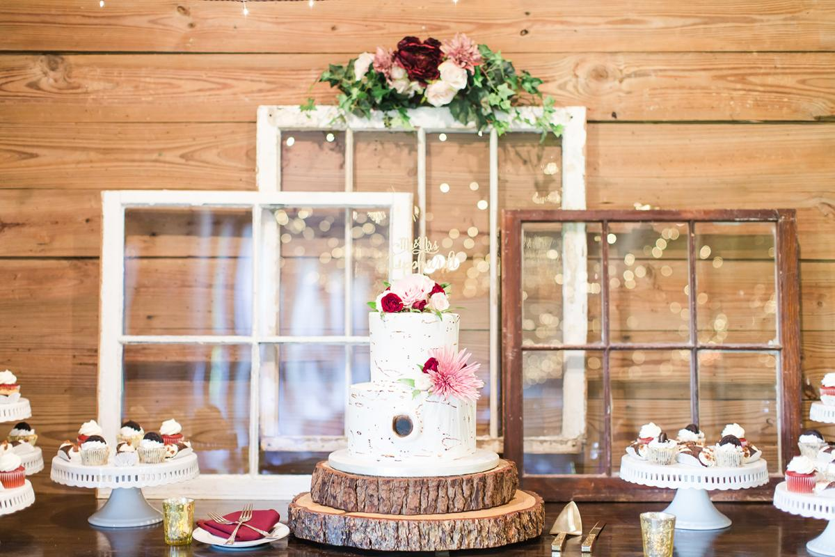 Cake table and wedding day sweets at Savannah and William's Carriage House Stable wedding.
