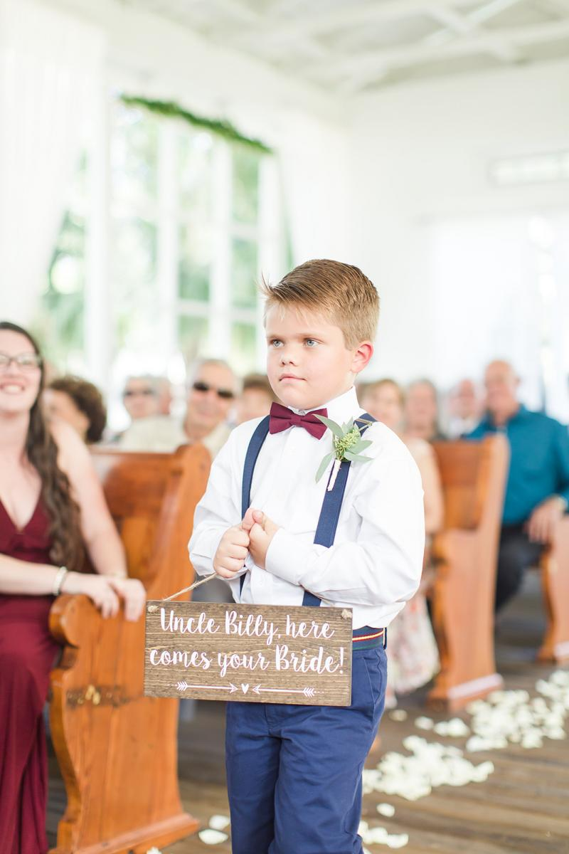 The ring bearer walks down the aisle