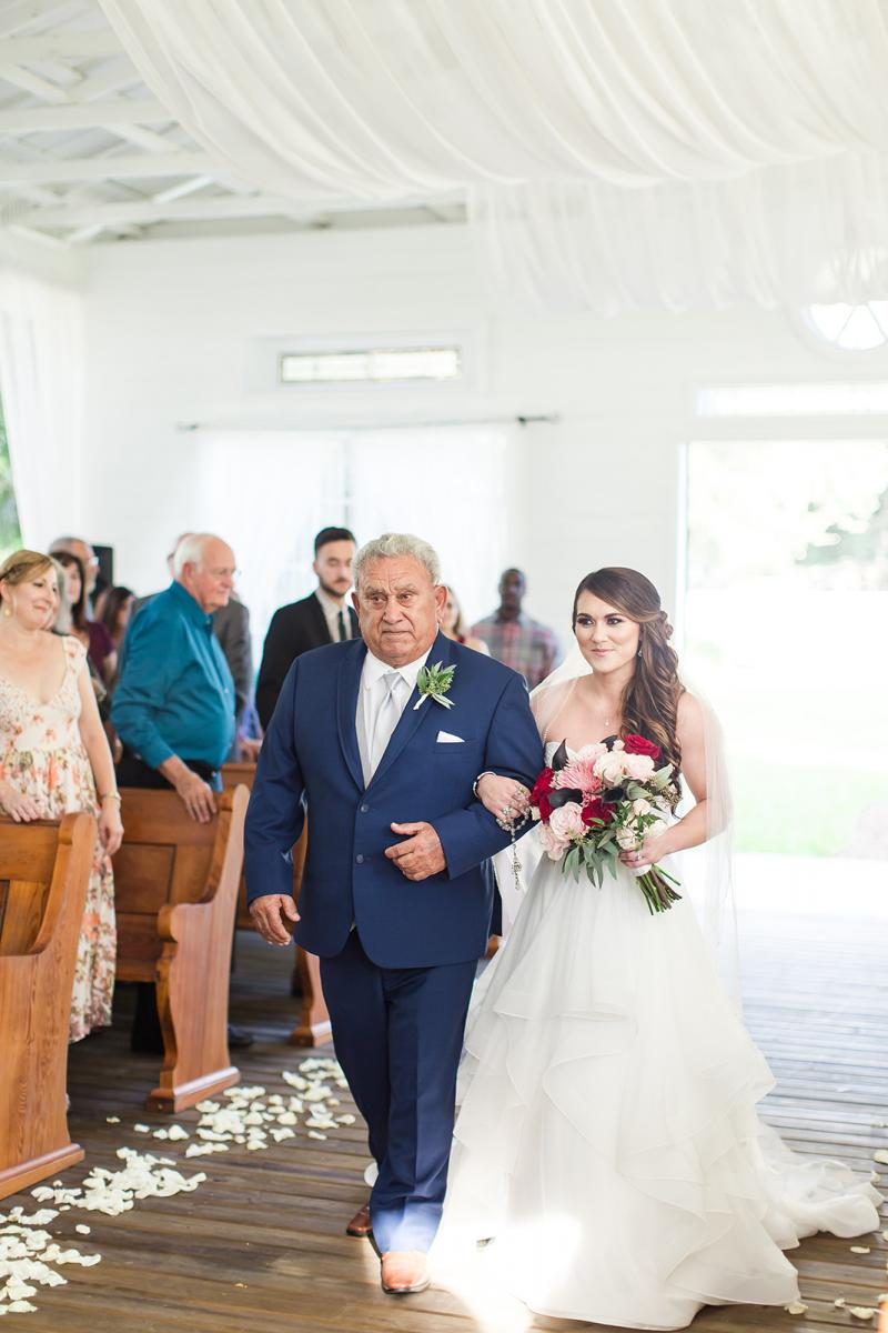 Savannah walks down the aisle with her father