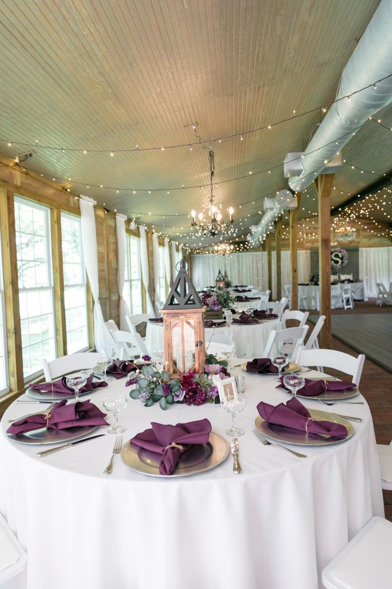 Purple and white wedding reception decor